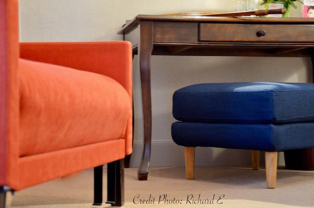 Chauffeuse orange pouf bleu hotel hannah elizabeth interior design