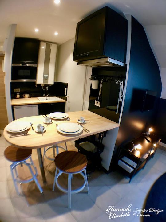 Cuisine ouvert studio noir blanc bois
